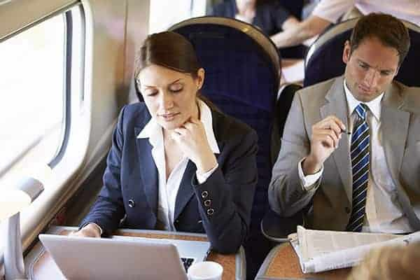 business people working on a train