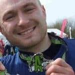 Simon with his medal following the Insane Terrain run.