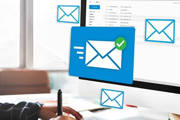 How to manage several freelance clients at once - Virtual emails flying out of a computer screen