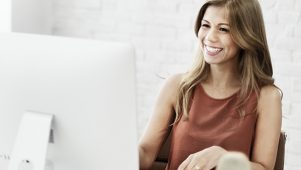 What is a personal service company? Cheerful female business owner at her computer