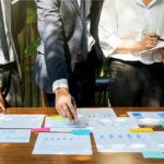 Things to consider before starting a consultancy business - consultant in business meeting with a client.