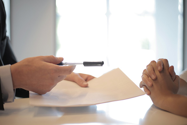 Freelancer agreeing and signing business loan during bank meeting