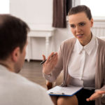 Caunce OHara - grow your counselling business online - Counsellor in therapy session with client